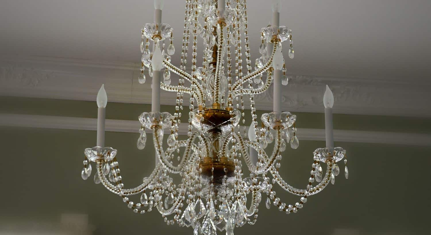 Elegant brass and crystal chandelier with candelabra bulbs