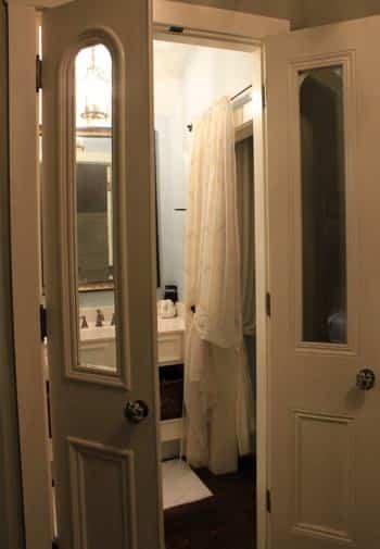 New Orleans guest bath seen through double glass doors