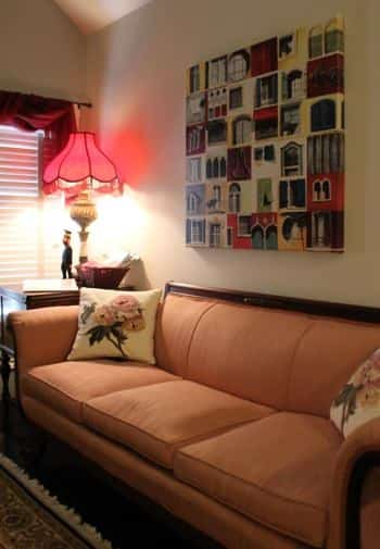 Savannah guest room with vaulted ceiling, sofa with apricot colored cushions, and side table with lamp next to window