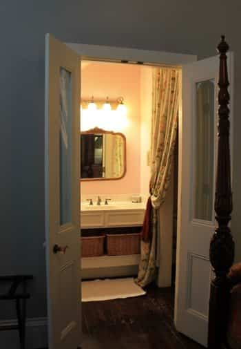 Savannah guest room with view of guest bath from open double French doors